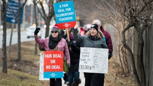 Teachers of the Peel District School Board hold a one day rotating strike in Mississauga, Ont., on Tuesday, February 4, 2020. THE CANADIAN PRESS/Nathan Denette