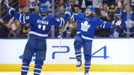 Toronto Maple Leafs right wing William Nylander (88) celebartes his goal against the Pittsburgh Penguins with teammate Zach Hyman (11)during second period NHL hockey action in Toronto on Thursday, Feb. 20, 2020. THE CANADIAN PRESS/Nathan Denette