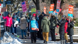 Striking teachers from Kew Beach Junior Public School in Toronto cheer as passing cars honk their horns in support on Monday, January 20, 2020. The union representing Ontario's public elementary teachers is holding another one-day strike today to ramp up pressure on the government during tense contract talks. THE CANADIAN PRESS/Frank Gunn