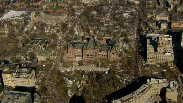 Protesters are seen at Queen's Park Crescent on Friday afternoon in this aerial image.