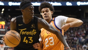 Toronto Raptors forward Pascal Siakam (43) moves around Phoenix Suns forward Cameron Johnson (23) during second half NBA basketball action in Toronto on Friday, Feb. 21, 2020. THE CANADIAN PRESS/Frank Gunn
