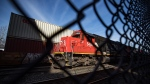 CN Rail locomotives are moved on tracks past cargo containers sitting on idle train cars at port in Vancouver, on Friday, February 21, 2020. Rail blockades across the country have led to an increase in the number of cargo ships waiting to load or unload according to the Port of Vancouver. THE CANADIAN PRESS/Darryl Dyck