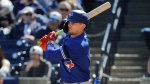 Toronto Blue Jays' Cavan Biggio follows through on a single during the fourth inning of a spring training baseball game against the New York Yankees Saturday, Feb. 22, 2020, in Tampa. (AP Photo/Frank Franklin II)