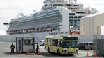 Diamond Princess cruise ship leaves a port in Yokohama, near Tokyo, Wednesday, Feb. 19, 2020. Passengers tested negative for COVID-19 started disembarking Wednesday. THE CANADIAN PRESS/AP/Eugene Hoshiko