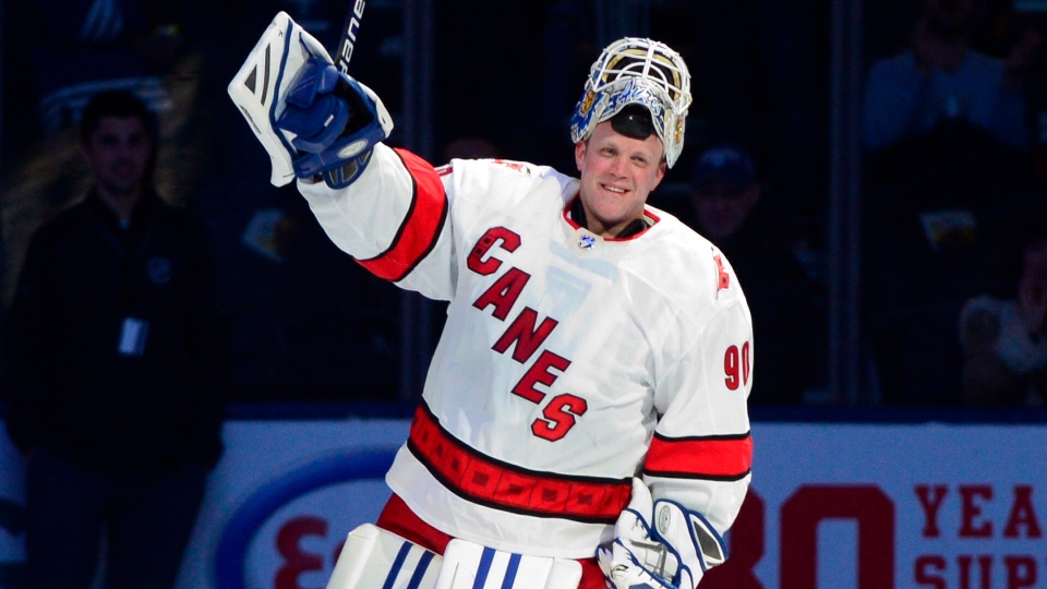 Carolina Hurricanes emergency goaltender David Ayres skates a lap after being named the game's first star after they beat the Toronto Maple Leafs 6-3 in NHL hockey action in Toronto, Saturday, Feb. 22, 2020. THE CANADIAN PRESS/Frank Gunn