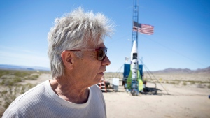 "In this March 6, 2018, file photo, ""Mad"" Mike Hughes reacts after the decision to scrub another launch attempt of his rocket near Amboy, Calif. The self-styled daredevil died Saturday, Feb. 22, 2020, after a rocket in which he launched himself crashed into the ground, a colleague and a witness said.  (James Quigg/Daily Press via AP, File)"