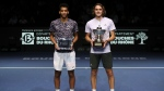 Stefanos Tsitsipas of Greece, right, celebrates winning the men's singles final of the Open 13 Provence tennis tournament against Felix Auger-Aliassime of Canada, left, in two sets, 6-3, 6-4, in Marseille, southern France, Sunday, Feb. 23, 2020. (AP Photo/Daniel Cole)