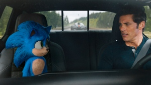 "This image released by Paramount Pictures shows Sonic, voiced by Ben Schwartz, left, and James Marsden in a scene from ""Sonic the Hedgehog ."" (Paramount Pictures/Sega of America via AP)"