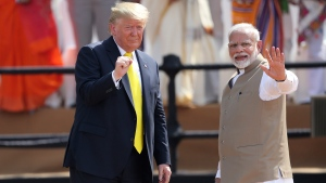 U.S. President Donald Trump and Indian Prime Minister Narendra Modi gesture towards the crowd during the 'Namaste Trump' event at Sardar Patel Stadium in Ahmedabad, India, Monday, Feb. 24, 2020. Basking in adulation from a massive, colorful crowd, Trump and Modi lavished each other with praise Monday in a reaffirmation of U.S.-India ties as the subcontinent poured on the pageantry in a joyful welcome for the U.S. president. (AP Photo/Aijaz Rahi)