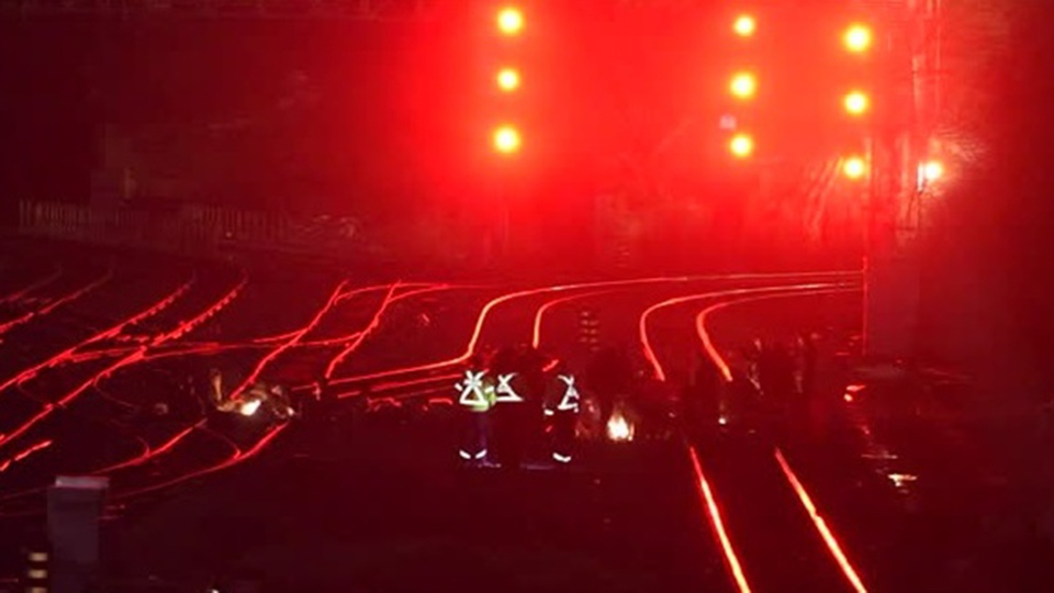 Demonstrators sit on rail tracks near Aldershot in Burlington on Feb. 25, 2020.