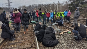 Protesters block the rail lines near Kipling GO Station Tuesday February 25, 2020. (Tracy Tong /CTV News Toronto).