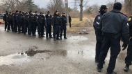 Police officers are pictured near a protest on rail lines close to Kipling GO Station Tuesday February 25, 2020. (Tracy Tong /CTV News Toronto).