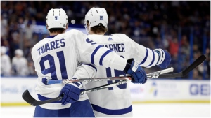 Toronto Maple Leafs center John Tavares (91) celebrates his goal against the Tampa Bay Lightning with right wing Mitchell Marner (16) during the first period of an NHL hockey game Tuesday, Feb. 25, 2020, in Tampa, Fla. (AP Photo/Chris O'Meara)