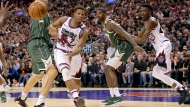 Toronto Raptors guard Kyle Lowry (7) passes the ball across Milwaukee Bucks centre Brook Lopez (11) during second half NBA basketball action in Toronto, Tuesday, Feb. 25, 2020. THE CANADIAN PRESS/Nathan Denette