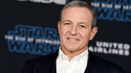 "In this Dec. 16, 2019, file photo, Disney CEO Robert Iger arrives at the world premiere of ""Star Wars: The Rise of Skywalker"", in Los Angeles. (Jordan Strauss/Invision/AP, FIle)"