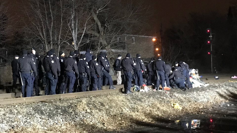 Police officer move in on a blockade on rail tracks near the Lambton Arena in Toronto. (CP24)