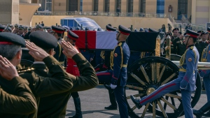 A horse-drawn carriage carries the flag-draped coffin of former autocratic President Hosni Mubarak during his funeral, at Tantawi Mosque, in eastern Cairo, Egypt, Wednesday, Feb. 26, 2020. Egypt is holding a full-honors military funeral for Mubarak who was ousted from power in the 2011 Arab Spring uprising. The 91-year-old Mubarak died on Tuesday at a Cairo military hospital from heart and kidney complications. (AP Photo/Hamada Elrasam)