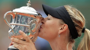 "In this June 9, 2012, file photo, Maria Sharapova of Russia holds the trophy after winning the women's final match against Sara Errani of Italy at the French Open tennis tournament at Roland Garros stadium in Paris. Sharapova is retiring from professional tennis at the age of 32 after five Grand Slam titles and time ranked No. 1. She has been dealing with shoulder problems for years. In an essay written for Vanity Fair and Vogue about her decision to walk away from the sport, posted online Wednesday, Feb. 26, 2020, Sharapova asks: ""How do you leave behind the only life you've ever known?""(AP Photo/Bernat Armangue, File)"