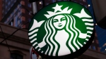 This June 26, 2019, photo shows a Starbucks sign outside a Starbucks coffee shop in downtown Pittsburgh. Starbucks customers in Canada will soon be able to down fake meat with their Frappuccinos. (AP Photo/Gene J. Puskar)