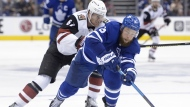 The Toronto Maple Leafs have signed signed defenceman Jake Muzzin to a four-year contract extension. Muzzin (8) skates with the puck as Arizona Coyotes left wing Lawson Crouse (67) defends in this Tuesday Feb. 11, 2020 photo. THE CANADIAN PRESS/Nathan Denette