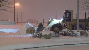 A plow is seen clearing snow in Toronto on Thursday, Feb. 27, 2020.