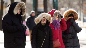 People wait to cross a street in Chinatown during a cold and windy day in Toronto on Thursday, January 10, 2019. The city declared an extreme cold alert. THE CANADIAN PRESS/Nathan Denette