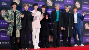 FILE - In this Jan. 5, 2020, file photo, members of South Korean K-Pop group BTS pose for photos during the Golden Disk Awards in Seoul, South Korea. BTS canceled a series of planned concerts in Seoul in April due to concerns about a soaring viral outbreak in South Korea, the band's management agency said Friday, Feb. 28, 2020. (AP Photo/Ahn Young-joon, File)