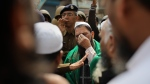 A man gestures as a senior Delhi police officer speaks to a group of Muslims ahead of Friday prayers in New Delhi, India, Friday, Feb. 28, 2020.  (AP Photo/Altaf Qadri)