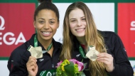 Canada's Jennifer Abel, left, and Melissa Citrini Beaulieu hold up their gold medals after winning the women's 3-metre synchro springboard final at the FINA Diving World Series in Montreal, Friday, February 28, 2020. THE CANADIAN PRESS/Graham Hughes