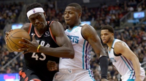Toronto Raptors forward Pascal Siakam (43) gets fouled by Charlotte Hornets guard Terry Rozier (3) during first half NBA basketball action in Toronto, Friday, Feb. 28, 2020. THE CANADIAN PRESS/Nathan Denette