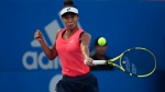 Canada's Leylah Fernandez returns a ball in her women's final match against Heather Watson of Great Britain at the Mexican Tennis Open in Acapulco, Mexico, Saturday, Feb. 29, 2020.(AP Photo/Rebecca Blackwell)