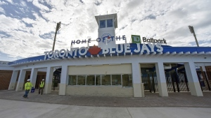 Construction workers walk past the main entrance to the TD Ballpark, the Florida home of Toronto Blue Jays, as they get the stadium ready in Dunedin, Fla., Sunday, Feb. 16, 2020. Blue Jays fans visiting Toronto's spring training stadium in Florida will be treated to an upgraded game-watching experience this season, and perhaps a lesson in community history, thanks to a hefty renovation at the ballpark that began early last year. THE CANADIAN PRESS/Steve Nesius