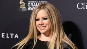 Avril Lavigne arrives at the Pre-Grammy Gala And Salute To Industry Icons at the Beverly Hilton Hotel on January 25, 2020, in Beverly Hills, Calif. Avril Lavigne is among the latest musicians to postpone international tour dates in response to the growing number of coronavirus cases.The Canadian pop singer posted a message to fans on social media saying she would no longer be touring Asia in April and May due to the viral outbreak. THE CANADIAN PRESS/AP, Invision - Mark Von Holden