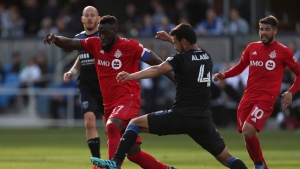 Toronto FC's Jozy Altidore (17) battles for the ball with San Jose Earthquakes' Oswaldo Alanis (4) during the second half on an MLS soccer game in San Jose, Calif., on February 29, 2020. THE CANADIAN PRESS/AP, Jed Jacobsohn