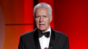 FILE - In this April 30, 2017, file photo, Alex Trebek speaks at the 44th annual Daytime Emmy Awards at the Pasadena Civic Center in Pasadena, Calif. Trebek marked his one-year battle against pancreatic cancer with candor about how hard it's been and a vow to keep going. (Photo by Chris Pizzello/Invision/AP, File)