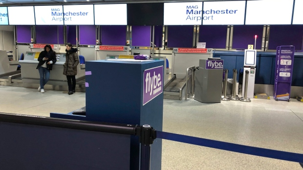 Unmanned check-in desks at Terminal 3 of Manchester Airport, as Flybe, Europe's biggest regional airline, has collapsed into administration, in Manchester, England, Thursday March 5, 2020.  UK Civil Aviation Authority (CAA) said Thursday that financially troubled Flybe had entered administration, leaving passengers stranded and told to find their own way home. (Peter Byrne/PA via AP)