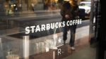 The front window of a downtown Starbucks Coffee store is shown in Toronto, May 10, 2018. Starbucks is stopping the use of reuseable cups and is halting business travel to combat the spread of the novel coronavirus. THE CANADIAN PRESS/Graeme Roy