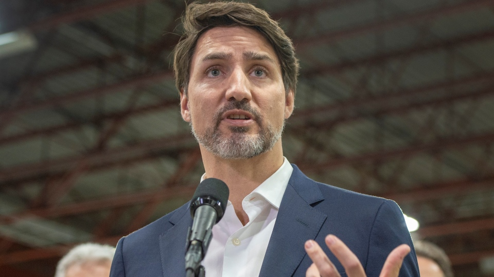 Prime Minister Justin Trudeau speaks to the media while touring the Lion Electric bus factory, Wednesday, March 4, 2020 in St-Jerome, Que..THE CANADIAN PRESS/Ryan Remiorz