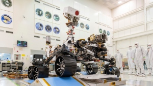 "In this Dec. 17, 2019 photo made available by NASA, engineers watch the first driving test for the Mars 2020 rover in a clean room at the Jet Propulsion Laboratory in Pasadena, Calif. On Thursday, March 5, 2020, NASA announced the explorer's name will be ""Perseverance."" (J. Krohn/NASA via AP)"