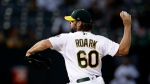 Oakland Athletics pitcher Tanner Roark works against the Kansas City Royals in the first inning of a baseball game Monday, Sept. 16, 2019, in Oakland, Calif. (AP Photo/Ben Margot)