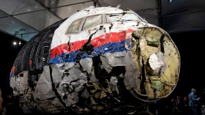 This Tuesday, Oct. 13, 2015 file photo, shows the reconstructed wreckage of Malaysia Airlines Flight MH17, put on display during a press conference in Gilze-Rijen, central Netherlands. United by grief across oceans and continents, families who lost loved ones when Malaysia Airlines Flight 17 was shot down in 2014 hope that a trial starting next week will finally deliver them something that has remained elusive ever since: The truth. (AP Photo/Peter Dejong, File)