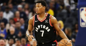 Toronto Raptors guard Kyle Lowry (7) dribbles the ball up the court against the Golden State Warriors during the first half of an NBA basketball game in San Francisco, Thursday, March 5, 2020. (AP Photo/Jeff Chiu)