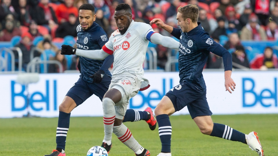 Toronto FC forward Jozy Altidore (17) drives between New York City defender Ronald Matarrita, left, and New York City midfielder James Sands (16) during first half MLS action in Toronto on Saturday March 7, 2020. THE CANADIAN PRESS/Chris Young