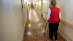 A resident walks down a hallway at a seniors' residence in Montreal, Thursday, Jan. 30, 2020. THE CANADIAN PRESS/Ryan Remiorz