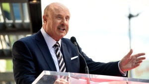 This Feb. 21, 2020 file photo shows talk show host Dr. Phil McGraw speaking during a ceremony awarding him with a star on the Hollywood Walk of Fame in Los Angeles. (AP Photo/Chris Pizzello, File)