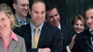 In this May 25, 2006, file photo, federal prosecutors Kathryn Ruemmler, left, Sean Berkowitz and John Hueston address the media outside the courthouse after the verdicts were delivered in the trial of former Enron executives Ken Lay and Jeff Skilling in Houston. Berkowitz is defending Lori Loughlin and her husband, Mossimo Giannulli, in 2020 against federal allegations that they bribed their daughters' way into the University of Southern California. (AP Photo/Pat Sullivan, File)