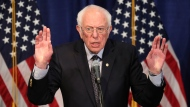 Democratic presidential candidate, Sen. Bernie Sanders, I-Vt., speaks to reporters on Wednesday, March 11, 2020, in Burlington, Vt. (AP Photo/Charles Krupa)