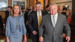 Ontario Premier Doug Ford is followed by Health Minister Christine Elliott and Minister of Finance Rod Phillips after answering questions following a meeting of all party leaders and health experts at the Ontario Legislature in Toronto on Wednesday March 11, 2020. THE CANADIAN PRESS/Frank Gunn