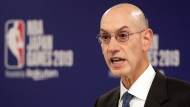 FILE - In this Oct. 8, 2019, file photo, NBA Commissioner Adam Silver speaks at a news conference before an NBA preseason basketball game between the Houston Rockets and the Toronto Raptors in Saitama, Japan. (AP Photo/Jae C. Hong, File)