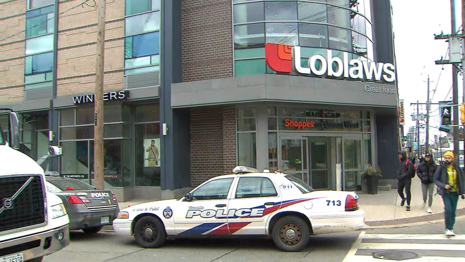 Police respond to a fight at a Loblaw's store at Queen and Portland streets in downtown Toronto Friday March 13, 2020.